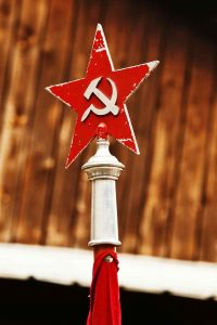 Red hammer and sickle emblem